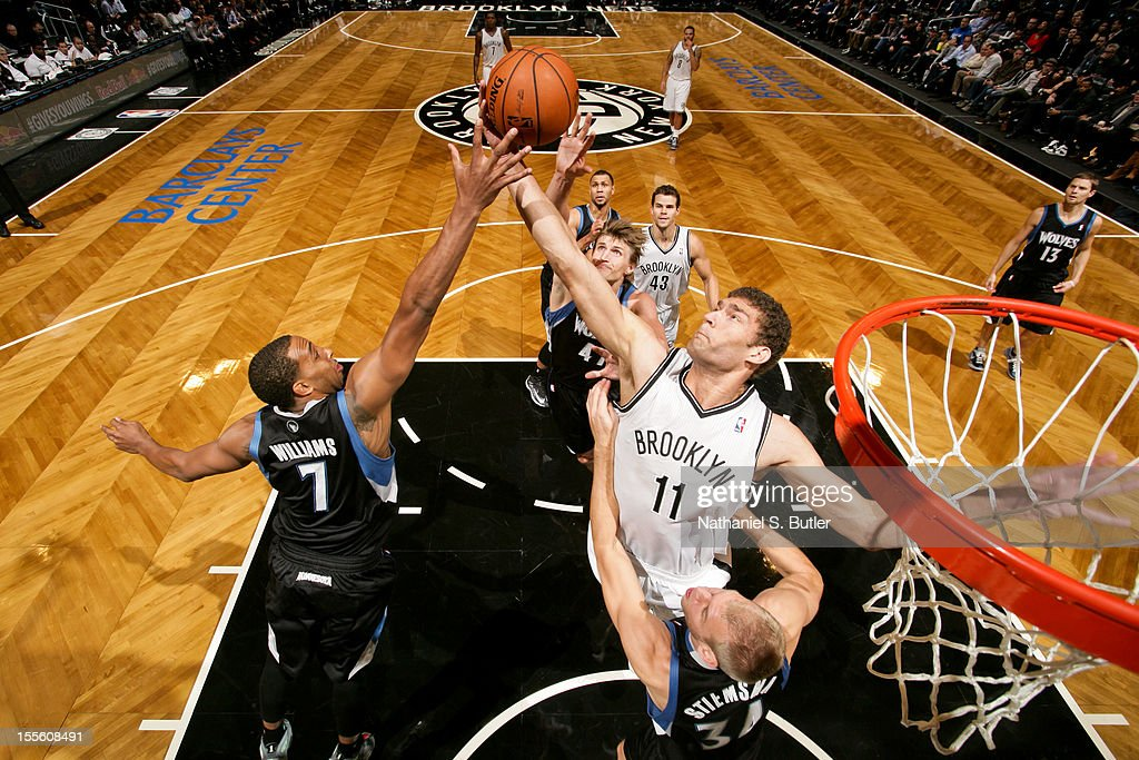 Brook Lopez #11 goes for a rebound against Derrick Williams #7 of the Minnesota Timberwolves on November 5, 2012 at the Barclays Center in Brooklyn, New York.