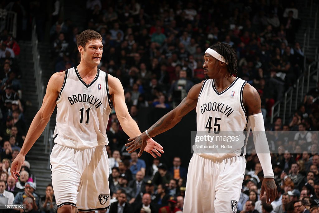 Brook Lopez #11 high-fives teammate Gerald Wallace #45 of the Brooklyn Nets while playing the Chicago Bulls in Game Five of the Eastern Conference Quarterfinals during the 2013 NBA Playoffs on April 29 at the Barclays Center in the Brooklyn borough of New York City.