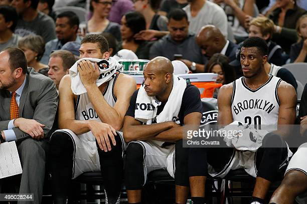 Brook Lopez Jarrett Jack and Thaddeus Young of the Brooklyn Nets watch from the bench as their team is defeated by the San Antonio Spurs at the ATT...