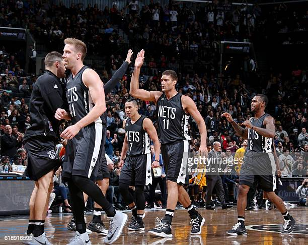 Brook Lopez Jeremy Lin and Sean Kilpatrick of the Brooklyn Nets react during a game against the Indiana Pacers on October 28 2016 at Barclays Center...