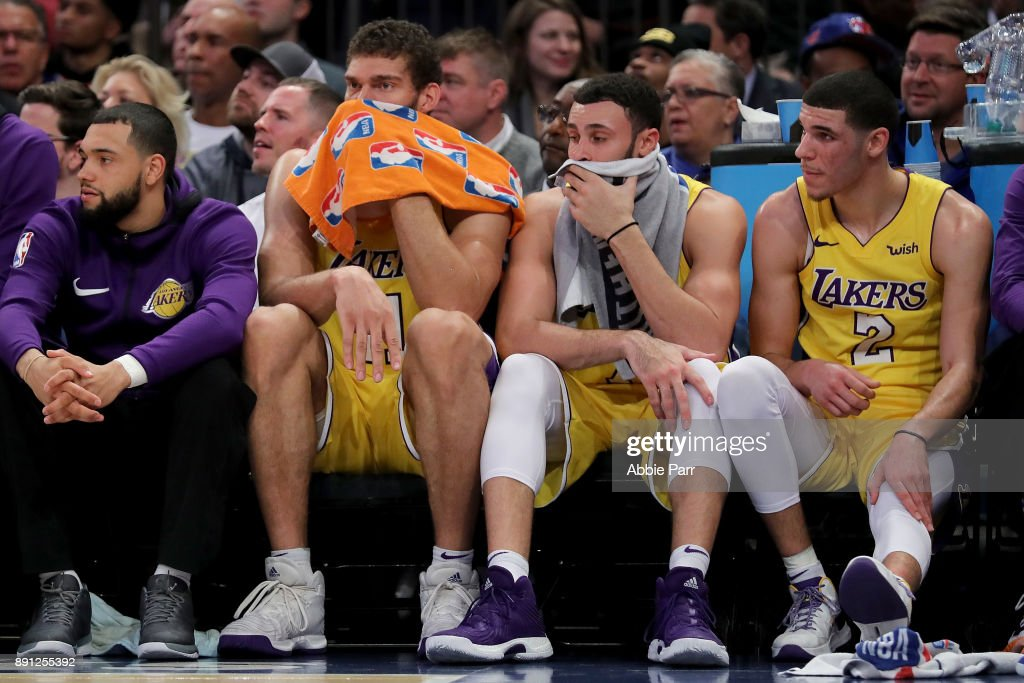 Brook Lopez #11 (L), Larry Nance Jr. #7 and Lonzo Ball #2 of the Los Angeles Lakers react from the bench in the fourth quarter against the New York Knicks during their game at Madison Square Garden on December 12, 2017 in New York City.