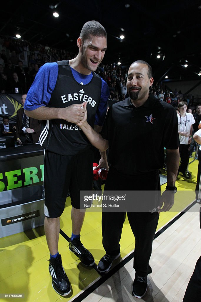 Brook Lopez #11 of the Brookln Nets and David Fizdale of the Miami Heat shake hands during the NBA All-Star Practice in Sprint Arena at Jam Session at Jam Session during NBA All Star Weekend on February 16, 2013 at the George R. Brown in Houston, Texas.