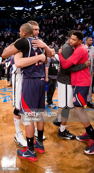 Brook Lopez of the Brooklyn Nets and Al Horford of the Atlanta Hawks greet each other after Game Six of the Eastern Conference Quarterfinals during...