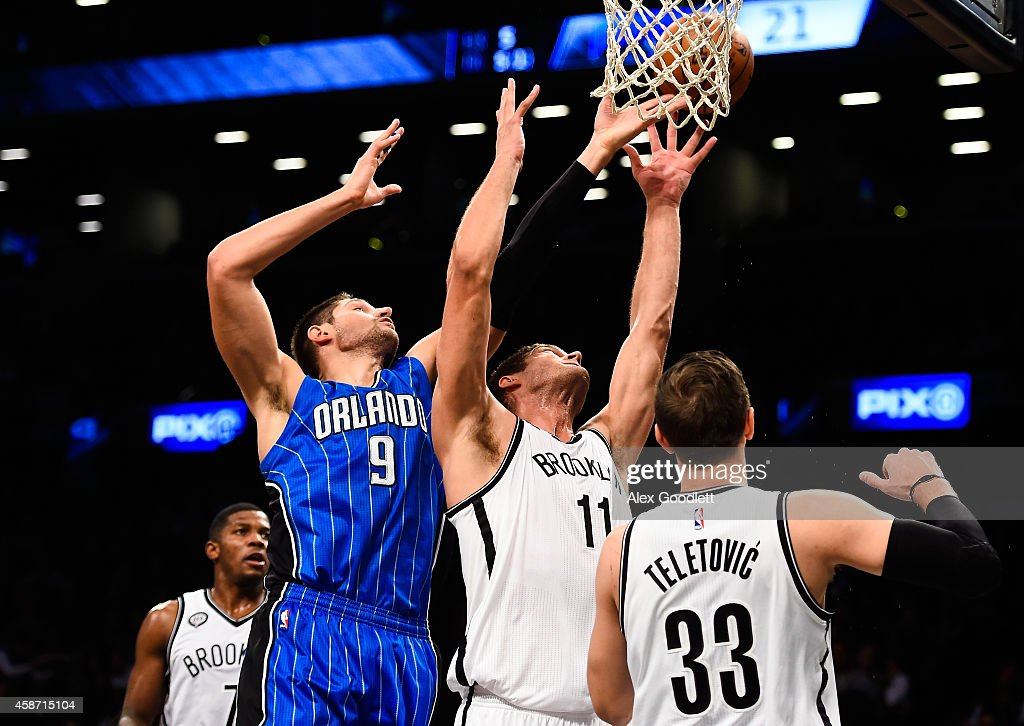 Brook Lopez #11 of the Brooklyn Nets attempts a rebound with Nikola Vucevic #9 of the Orlando Magic in the first half at the Barclays Center on November 9, 2014 in the Brooklyn borough of New York City.