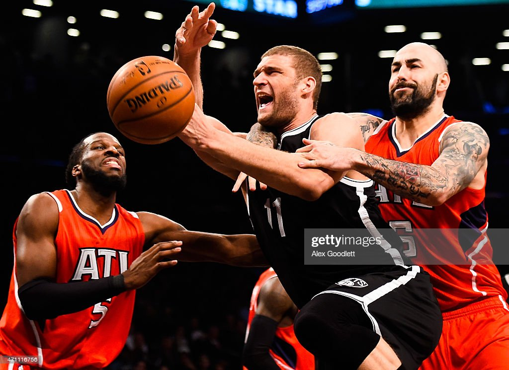 <a gi-track='captionPersonalityLinkClicked' href=/galleries/search?phrase=Brook+Lopez&family=editorial&specificpeople=3847328 ng-click='$event.stopPropagation()'>Brook Lopez</a> #11 of the Brooklyn Nets attempts to drive past Pero Antic #6 and <a gi-track='captionPersonalityLinkClicked' href=/galleries/search?phrase=DeMarre+Carroll&family=editorial&specificpeople=784686 ng-click='$event.stopPropagation()'>DeMarre Carroll</a> #5 of the Atlanta Hawks during the first round of the 2015 NBA Playoffs at Barclays Center on April 25, 2015 in the Brooklyn borough of New York City.