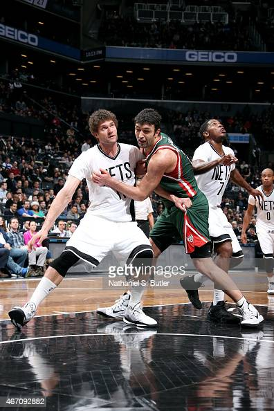 Brook Lopez of the Brooklyn Nets battles for position against Zaza Pachulia of the Milwaukee Bucks on March 20 2015 at Barclays Center in Brooklyn...