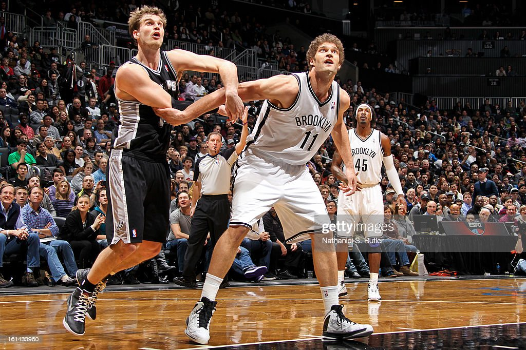 Brook Lopez #11 of the Brooklyn Nets battles for rebound position against Tiago Splitter #22 of the San Antonio Spurs on February 10, 2013 at the Barclays Center in the Brooklyn borough of New York City.