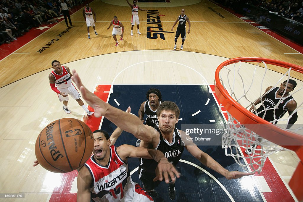 Brook Lopez #11 of the Brooklyn Nets blocks a shot by <a gi-track='captionPersonalityLinkClicked' href=/galleries/search?phrase=Garrett+Temple&family=editorial&specificpeople=709398 ng-click='$event.stopPropagation()'>Garrett Temple</a> #17 of the Washington Wizards on January 4, 2013 at the Verizon Center in Washington, DC.