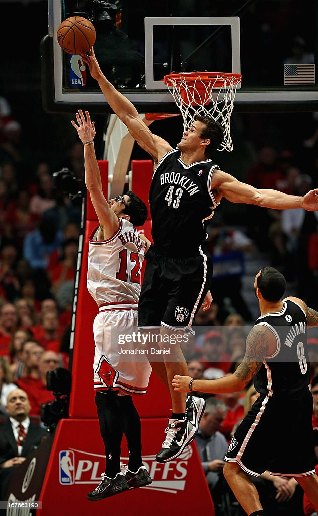 Brook Lopez of the Brooklyn Nets blocks a shot by Kirk Hinrich of the Chicago Bulls in Game Five of the Eastern Conference Quarterfinals in the 2013...