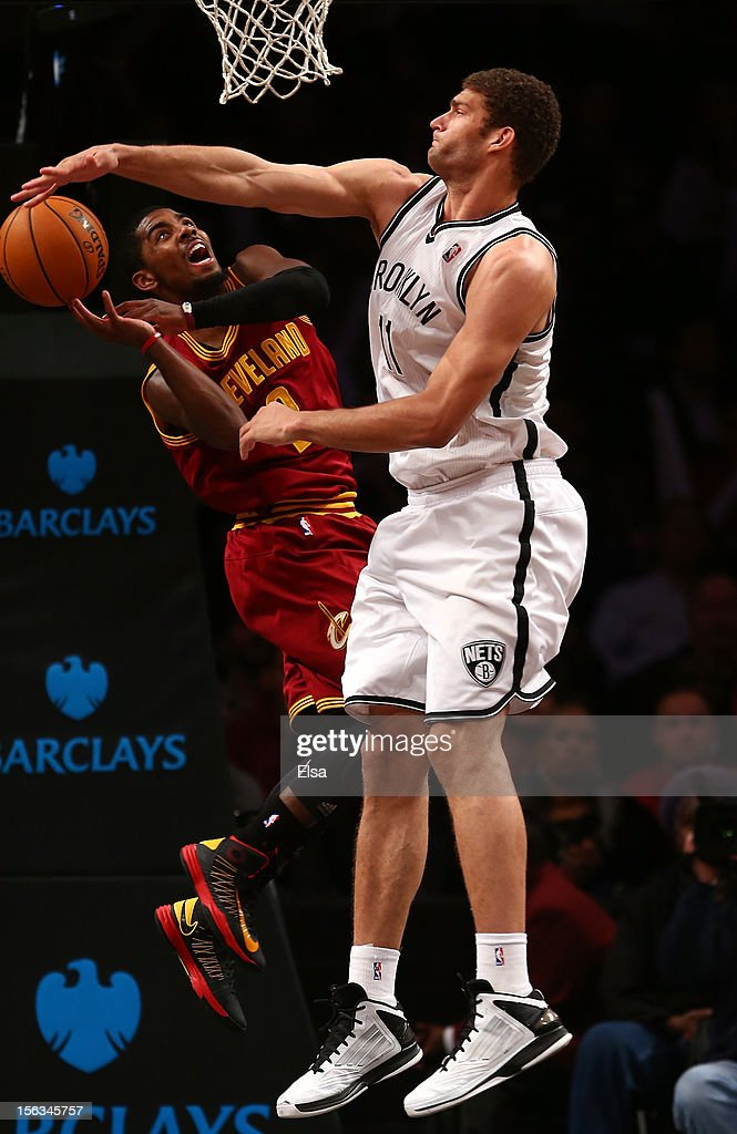 Brook Lopez of the Brooklyn Nets blocks a shot by Kyrie Irving of the Cleveland Cavaliers on November 13 2012 at the Barclays Center in the Brooklyn...