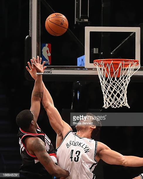 Brook Lopez of the Brooklyn Nets blocks a shot by Wesley Matthews of the Portland Trail Blazers at the Barclays Center on November 25 2012 in the...