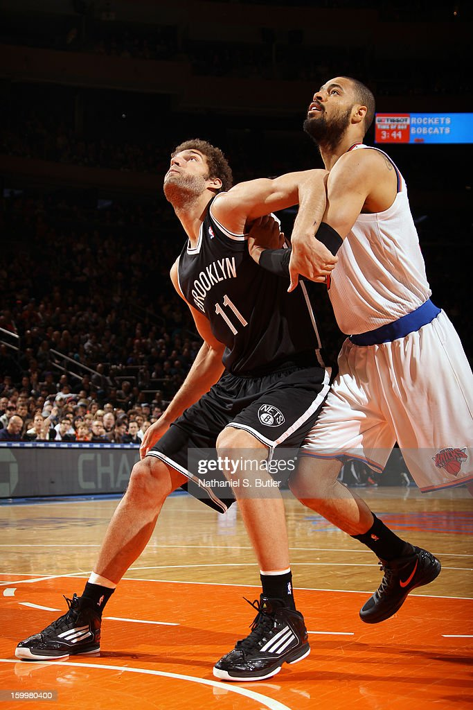 Brook Lopez #11 of the Brooklyn Nets boxes out Tyson Chandler #6 of the New York Knicks on January 21, 2013 at Madison Square Garden in New York City.