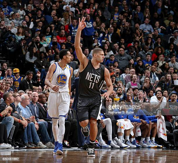 Brook Lopez of the Brooklyn Nets celebrates a three point basket against the Golden State Warriors on December 22 2016 at Barclays Center in Brooklyn...