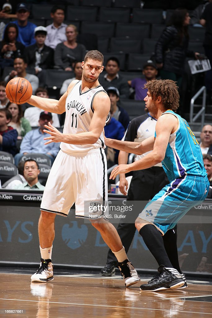 <a gi-track='captionPersonalityLinkClicked' href=/galleries/search?phrase=Brook+Lopez&family=editorial&specificpeople=3847328 ng-click='$event.stopPropagation()'>Brook Lopez</a> #11 of the Brooklyn Nets controls the ball against <a gi-track='captionPersonalityLinkClicked' href=/galleries/search?phrase=Robin+Lopez&family=editorial&specificpeople=2351509 ng-click='$event.stopPropagation()'>Robin Lopez</a> #15 of the New Orleans Hornets on March 12, 2013 at the Barclays Center in the Brooklyn borough of New York City.