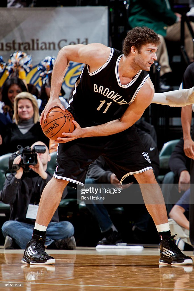 Brook Lopez #11 of the Brooklyn Nets controls the ball against the Indiana Pacers on February 11, 2013 at Bankers Life Fieldhouse in Indianapolis, Indiana.