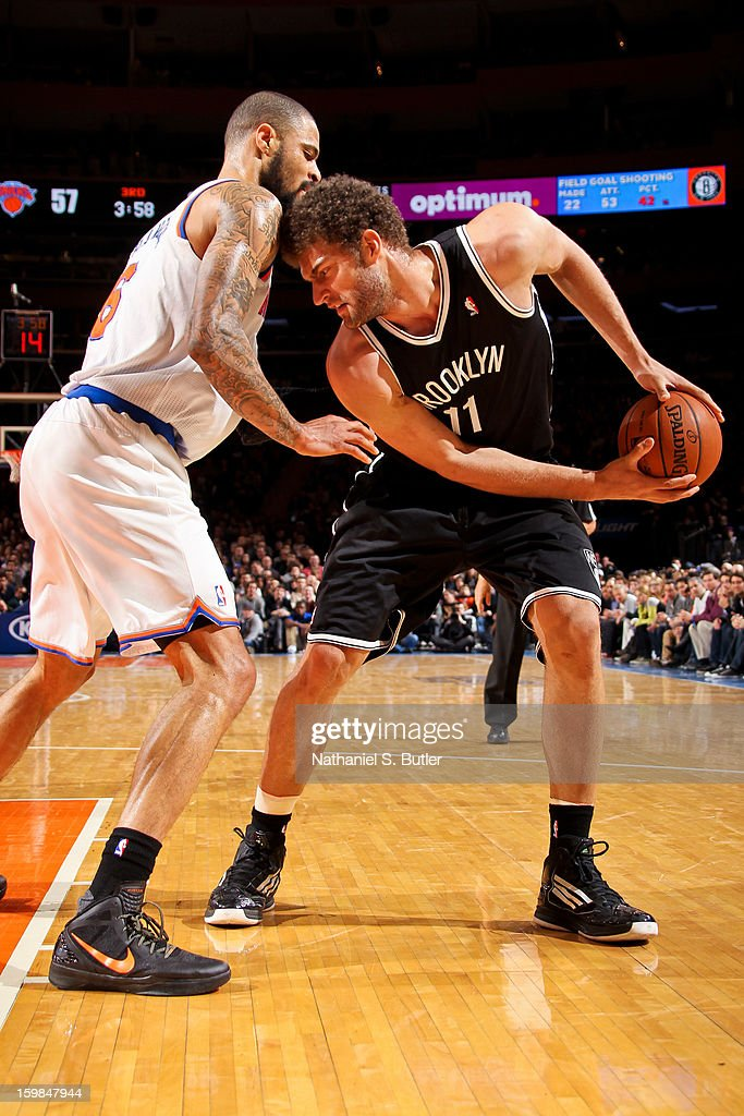 Brook Lopez #11 of the Brooklyn Nets controls the ball against Tyson Chandler #6 of the New York Knicks on January 21, 2013 at Madison Square Garden in New York City.