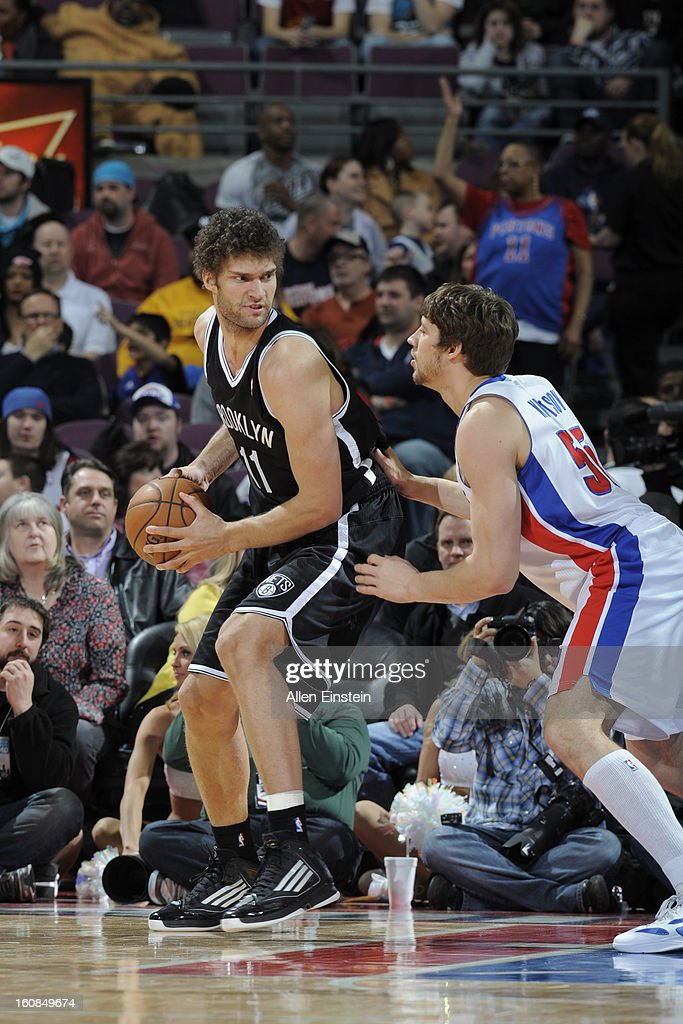 Brook Lopez of the Brooklyn Nets controls the ball against Viacheslav Kravtsov of the Detroit Pistons on February 6 2013 at The Palace of Auburn...