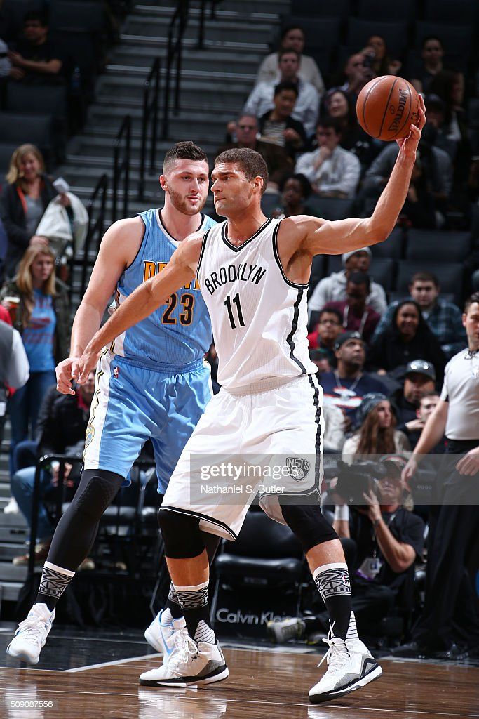 <a gi-track='captionPersonalityLinkClicked' href=/galleries/search?phrase=Brook+Lopez&family=editorial&specificpeople=3847328 ng-click='$event.stopPropagation()'>Brook Lopez</a> #11 of the Brooklyn Nets defends the ball against the Jusuf Nurkic #23 of the Denver Nuggets during the game on February 8, 2016 at Barclays Center in Brooklyn, New York.