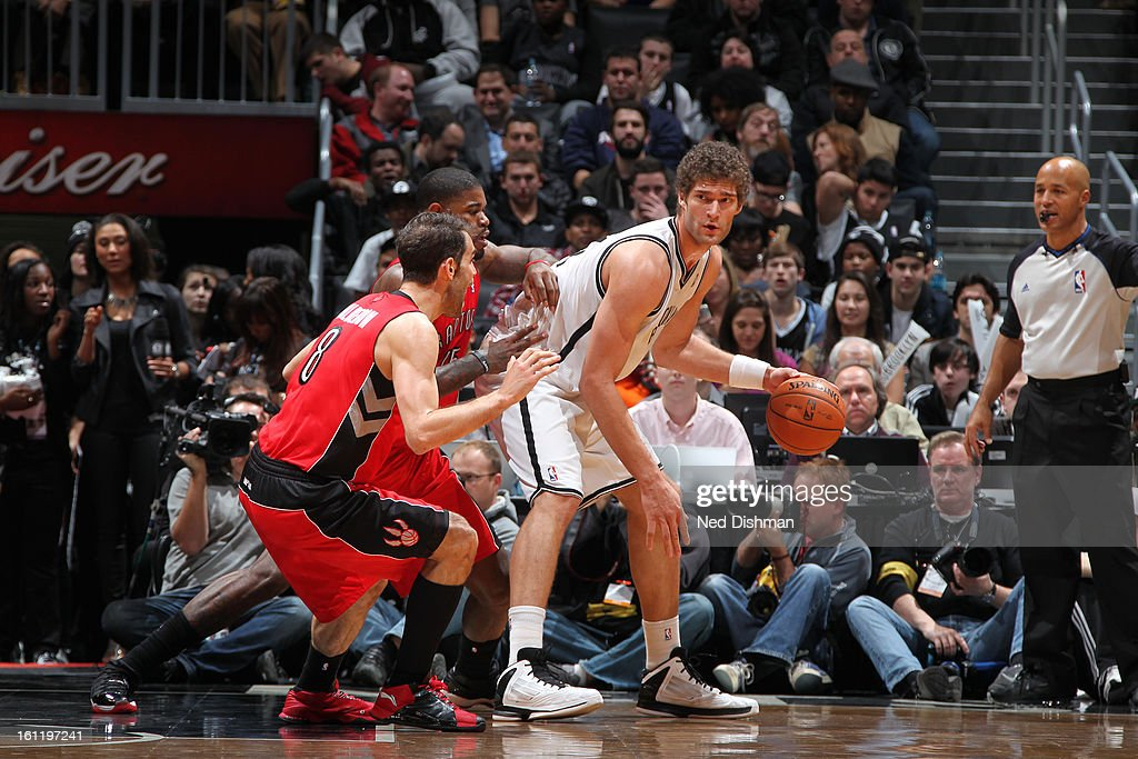 <a gi-track='captionPersonalityLinkClicked' href=/galleries/search?phrase=Brook+Lopez&family=editorial&specificpeople=3847328 ng-click='$event.stopPropagation()'>Brook Lopez</a> #11 of the Brooklyn Nets dribbles the ball against the Toronto Raptors at the Barclays Center on January 15, 2013 in the Brooklyn borough of New York City in New York City.