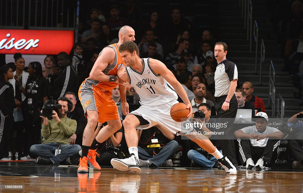 Brook Lopez #11 of the Brooklyn Nets dribbles to the basket against the Phoenix Suns during the game at the Barclays Center on January 11, 2013 in Brooklyn, New York.