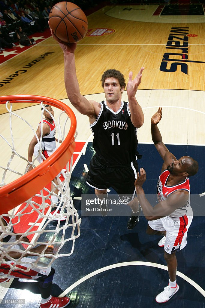 <a gi-track='captionPersonalityLinkClicked' href=/galleries/search?phrase=Brook+Lopez&family=editorial&specificpeople=3847328 ng-click='$event.stopPropagation()'>Brook Lopez</a> #11 of the Brooklyn Nets drives to the basket against <a gi-track='captionPersonalityLinkClicked' href=/galleries/search?phrase=Emeka+Okafor&family=editorial&specificpeople=201739 ng-click='$event.stopPropagation()'>Emeka Okafor</a> #50 of the Washington Wizards on February 8, 2013 at the Verizon Center in Washington, DC.