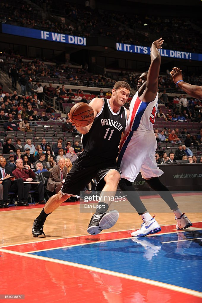 Brook Lopez #11 of the Brooklyn Nets drives to the basket against Jason Maxiell #54 of the Detroit Pistons on March 18, 2013 at The Palace of Auburn Hills in Auburn Hills, Michigan.