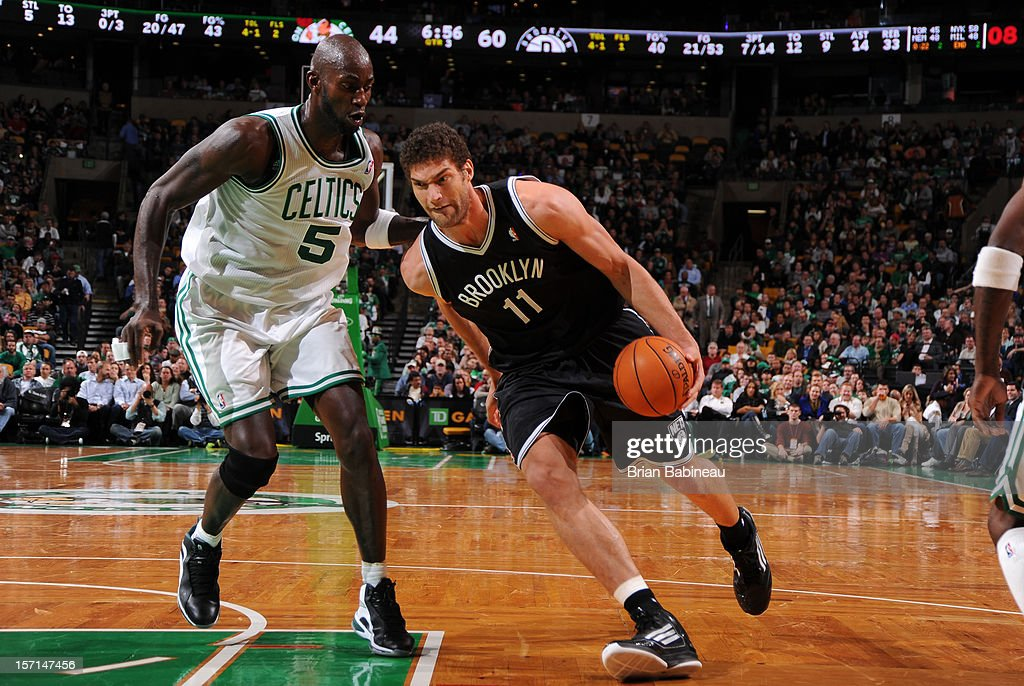 Brook Lopez #11 of the Brooklyn Nets drives to the basket against Kevin Garnett #5 of the Boston Celtics on November 28, 2012 at the TD Garden in Boston, Massachusetts.