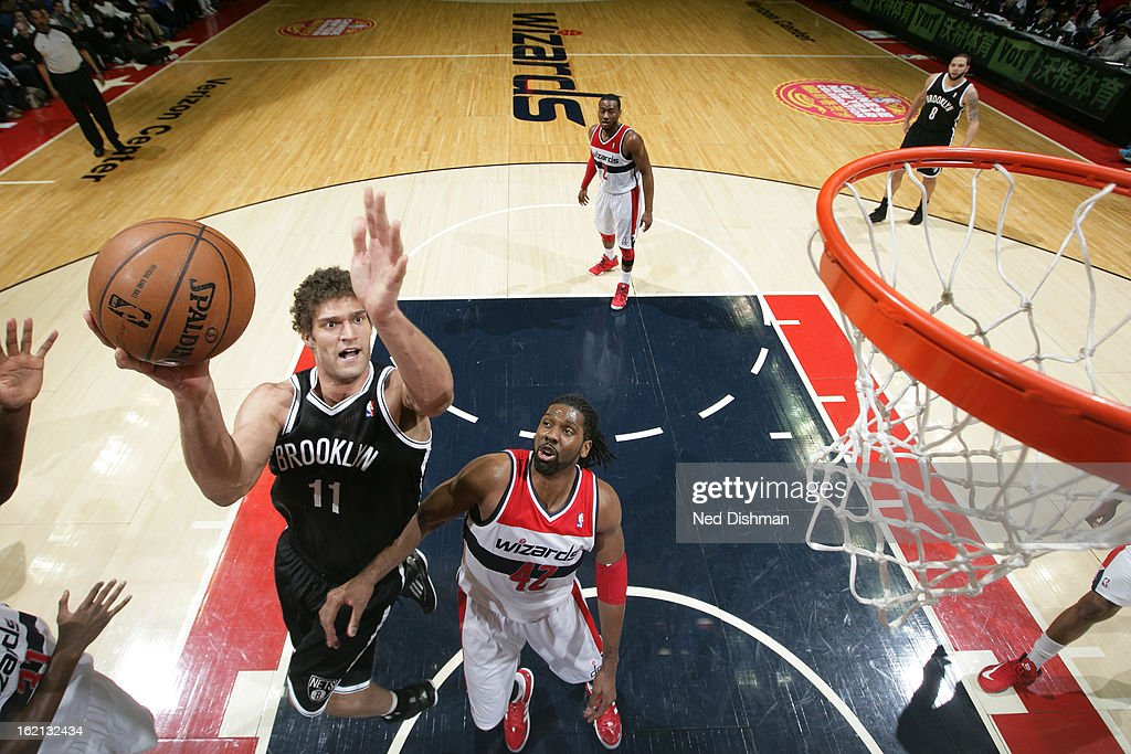 <a gi-track='captionPersonalityLinkClicked' href=/galleries/search?phrase=Brook+Lopez&family=editorial&specificpeople=3847328 ng-click='$event.stopPropagation()'>Brook Lopez</a> #11 of the Brooklyn Nets drives to the basket against Nene #42 of the Washington Wizards on February 8, 2013 at the Verizon Center in Washington, DC.