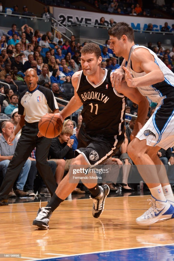 <a gi-track='captionPersonalityLinkClicked' href=/galleries/search?phrase=Brook+Lopez&family=editorial&specificpeople=3847328 ng-click='$event.stopPropagation()'>Brook Lopez</a> #11 of the Brooklyn Nets drives to the basket against Nikola Vucevic #9 of the Orlando Magic on November 3, 2013 at Amway Center in Orlando, Florida.
