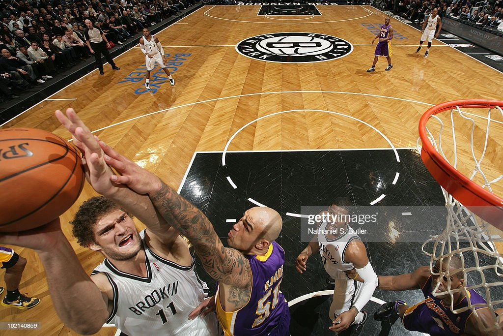 Brook Lopez #11 of the Brooklyn Nets drives to the basket against the Los Angeles Lakers on February 5, 2013 at the Barclays Center in the Brooklyn borough of New York City.