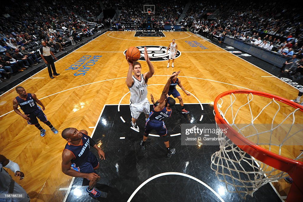<a gi-track='captionPersonalityLinkClicked' href=/galleries/search?phrase=Brook+Lopez&family=editorial&specificpeople=3847328 ng-click='$event.stopPropagation()'>Brook Lopez</a> #11 of the Brooklyn Nets drives to the basket against the Charlotte Bobcats during the game at the Barclays Center on December 28, 2012 in Brooklyn, New York.