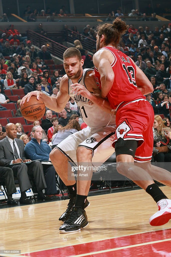 Brook Lopez #11 of the Brooklyn Nets drives to the basket against the Chicago Bulls on March 2, 2013 at the United Center in Chicago, Illinois.