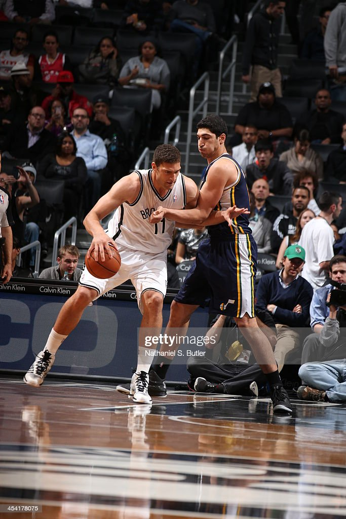 <a gi-track='captionPersonalityLinkClicked' href=/galleries/search?phrase=Brook+Lopez&family=editorial&specificpeople=3847328 ng-click='$event.stopPropagation()'>Brook Lopez</a> #11 of the Brooklyn Nets drives to the basket against the Utah Jazz during a game at Barclays Center on November 5, 2013 in the Brooklyn borough of New York City.