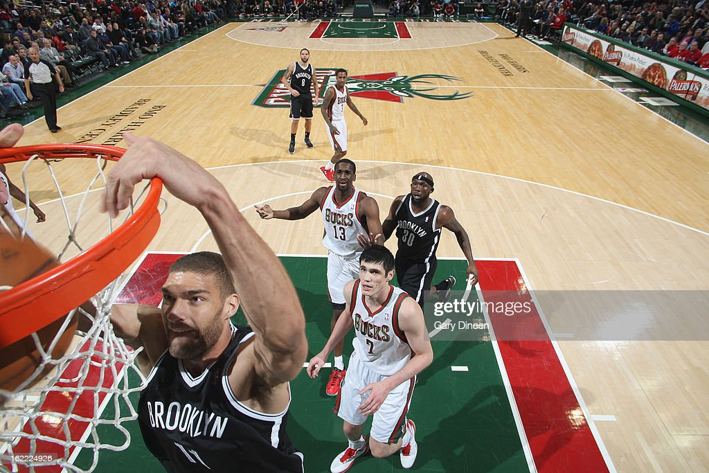 <a gi-track='captionPersonalityLinkClicked' href=/galleries/search?phrase=Brook+Lopez&family=editorial&specificpeople=3847328 ng-click='$event.stopPropagation()'>Brook Lopez</a> #11 of the Brooklyn Nets dunks against <a gi-track='captionPersonalityLinkClicked' href=/galleries/search?phrase=Ersan+Ilyasova&family=editorial&specificpeople=557070 ng-click='$event.stopPropagation()'>Ersan Ilyasova</a> #7 of the Milwaukee Bucks on February 20, 2013 at the BMO Harris Bradley Center in Milwaukee, Wisconsin.
