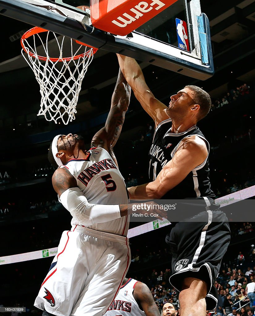 <a gi-track='captionPersonalityLinkClicked' href=/galleries/search?phrase=Brook+Lopez&family=editorial&specificpeople=3847328 ng-click='$event.stopPropagation()'>Brook Lopez</a> #11 of the Brooklyn Nets dunks against <a gi-track='captionPersonalityLinkClicked' href=/galleries/search?phrase=Josh+Smith+-+Basketball+Player+-+Born+1985&family=editorial&specificpeople=201983 ng-click='$event.stopPropagation()'>Josh Smith</a> #5 of the Atlanta Hawks at Philips Arena on March 9, 2013 in Atlanta, Georgia.