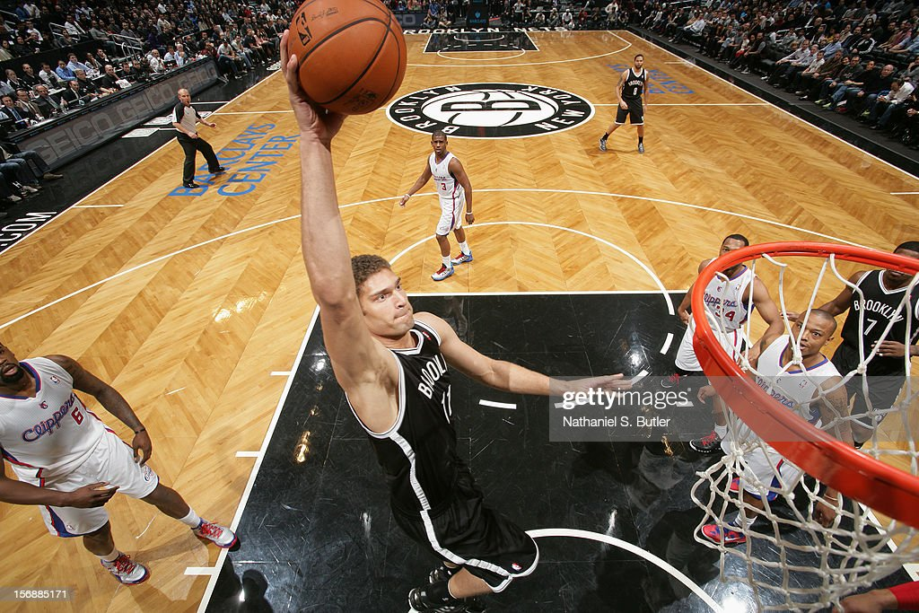 Brook Lopez #11 of the Brooklyn Nets dunks against the Los Angeles Clippers on November 23, 2012 at the Barclays Center in the Brooklyn Borough of New York City.
