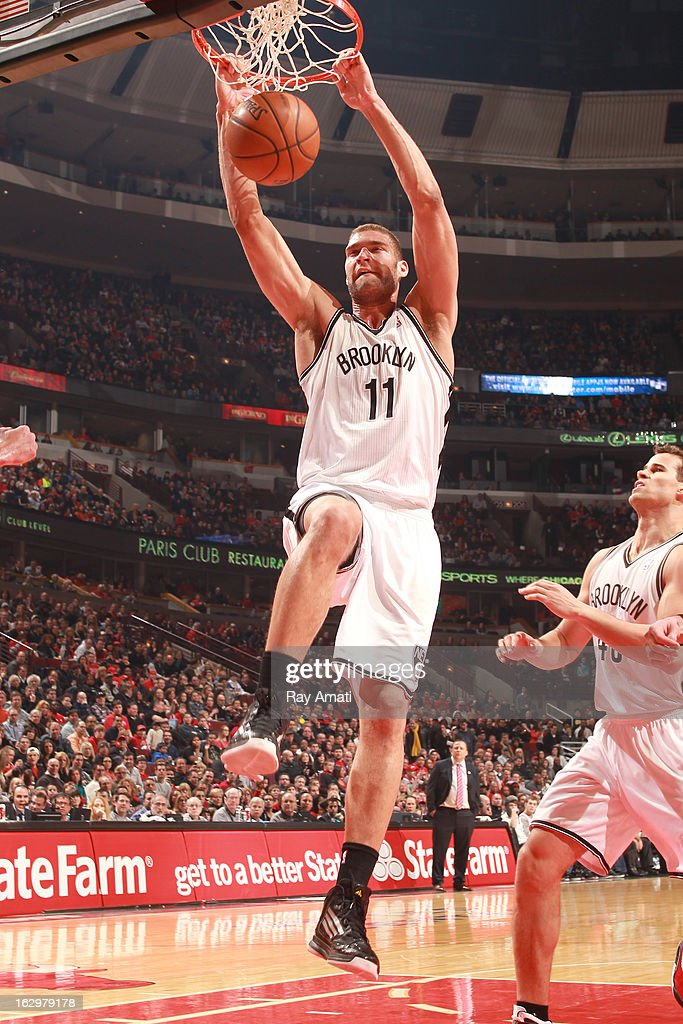 Brook Lopez #11 of the Brooklyn Nets dunks during the game against the Chicago Bulls on March 2, 2013 at the United Center in Chicago, Illinois.