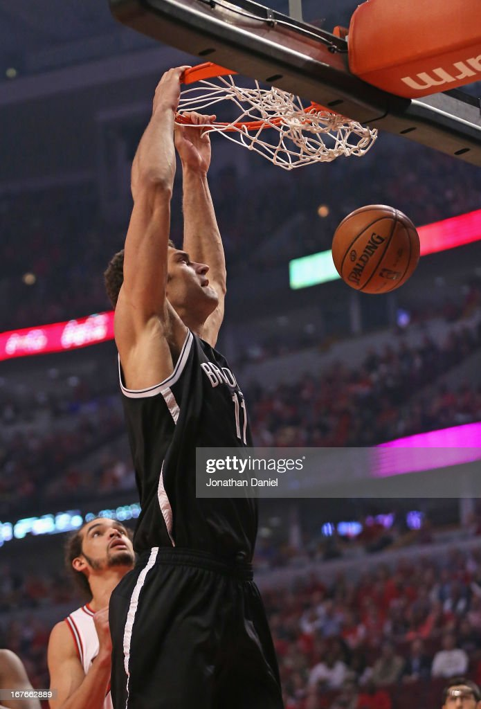Brook Lopez of the Brooklyn Nets dunks over Joakim Noah of the Chicago Bulls in Game Five of the Eastern Conference Quarterfinals in the 2013 NBA...