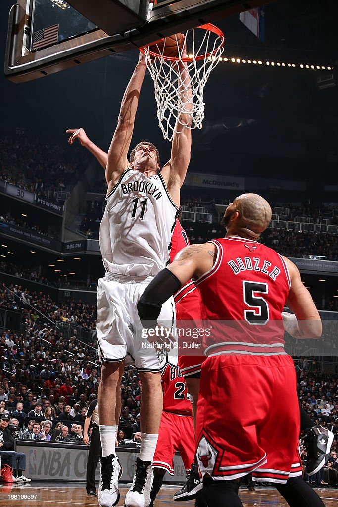 Brook Lopez #11 of the Brooklyn Nets dunks the ball against the Chicago Bulls during the Game Seven of the Eastern Conference Quarterfinals during the 2013 NBA Playoffs at the Barclays Center on May 4, 2013 in the Brooklyn borough of New York City.