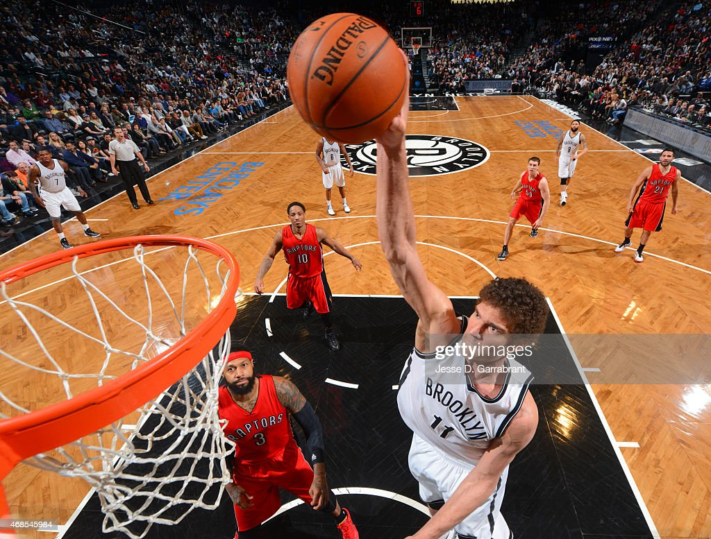 Brook Lopez #11 of the Brooklyn Nets dunks the ball against the Toronto Raptors at Barclays Center on April 3, 2015 in Brooklyn, New York