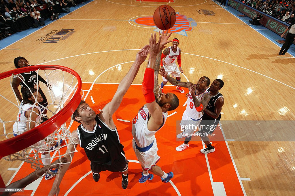 Brook Lopez #11 of the Brooklyn Nets fights for the rebound against Tyson Chandler #6 of the New York Knicks on December 19, 2012 at Madison Square Garden in New York City.