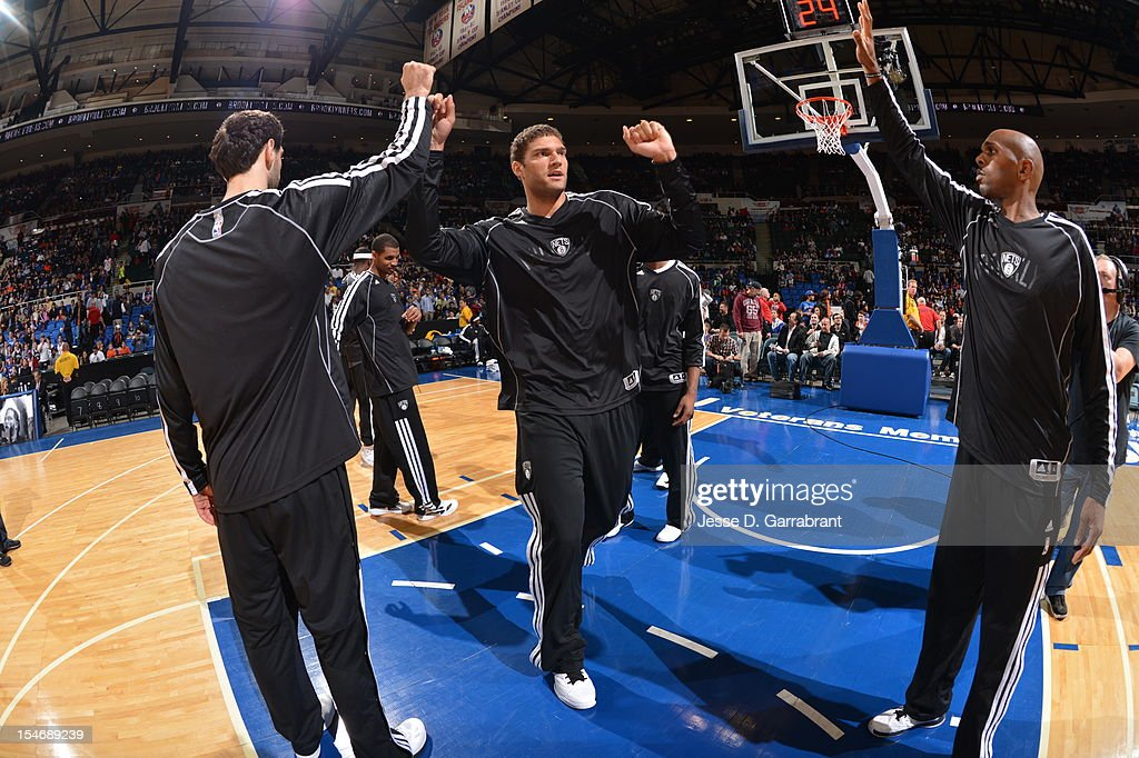 Brook Lopez #11 of the Brooklyn Nets gets introduced before the game against the New York Knicks on October 24, 2012 at the Nassau Veterans Memorial Coliseum in Long Island, New York.