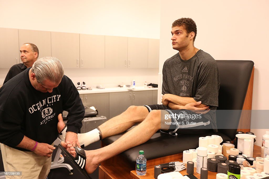 Brook Lopez #11 of the Brooklyn Nets gets taped before the game against the Chicago Bulls in Game One of the Eastern Conference Quarterfinals during the 2013 NBA Playoffs on April 20 at the Barclays Center in the Brooklyn borough of New York City.