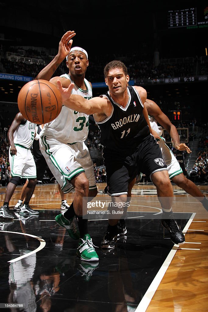 Brook Lopez #11 of the Brooklyn Nets goes for a loose ball against <a gi-track='captionPersonalityLinkClicked' href=/galleries/search?phrase=Paul+Pierce&family=editorial&specificpeople=201562 ng-click='$event.stopPropagation()'>Paul Pierce</a> #34 of the Boston Celtics during a pre-season game on October 18, 2012 at the Barclays Center in the Brooklyn borough of New York City.