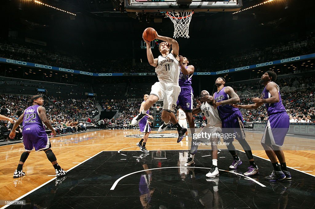 Brook Lopez #11 of the Brooklyn Nets goes to the basket against Jason Thompson #34 of the Sacramento Kings on January 5, 2013 at the Barclays Center in the Brooklyn borough of New York City.