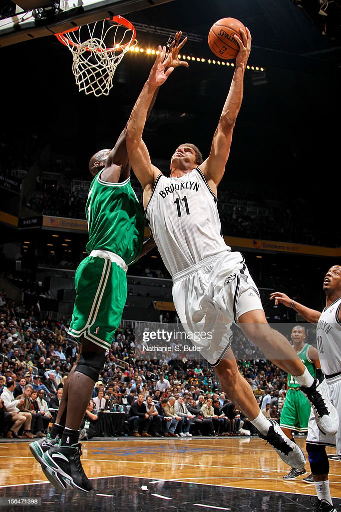 Brook Lopez #11 of the Brooklyn Nets goes to the basket against Kevin Garnett #5 of the Boston Celtics on November 15, 2012 at the Barclays Center in the Brooklyn Borough of New York City.