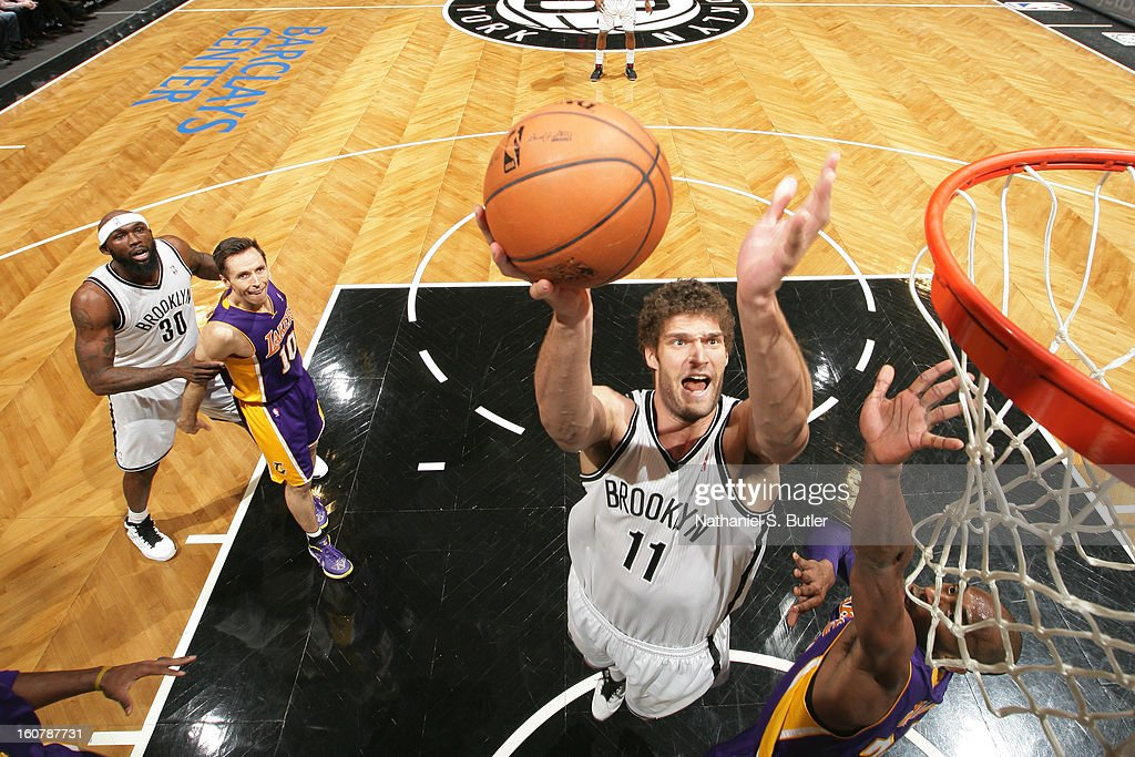 Brook Lopez #11 of the Brooklyn Nets goes to the basket against Kobe Bryant #24 of the Los Angeles Lakers on February 5, 2013 at the Barclays Center in the Brooklyn borough of New York City.