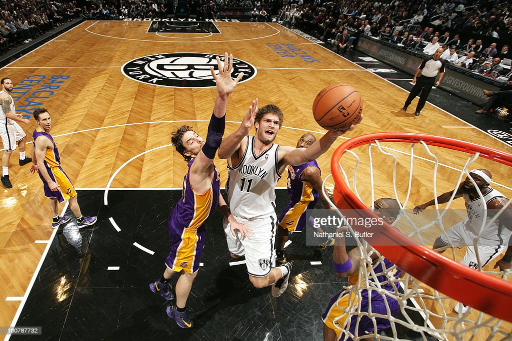 Brook Lopez #11 of the Brooklyn Nets goes to the basket against Pau Gasol #16 of the Los Angeles Lakers on February 5, 2013 at the Barclays Center in the Brooklyn borough of New York City.