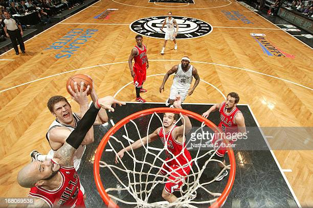 Brook Lopez of the Brooklyn Nets goes to the basket goes to the basket during the Game Seven of the Eastern Conference Quarterfinals between the...