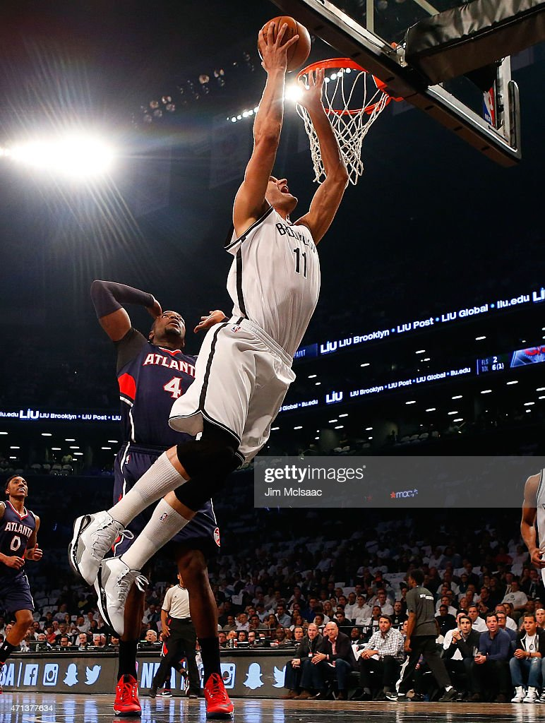 Brook Lopez #11 of the Brooklyn Nets goes to the hoop in the first quarter against <a gi-track='captionPersonalityLinkClicked' href=/galleries/search?phrase=Paul+Millsap&family=editorial&specificpeople=880017 ng-click='$event.stopPropagation()'>Paul Millsap</a> #4 of the Atlanta Hawks during game four in the first round of the 2015 NBA Playoffs at Barclays Center on April 27, 2015 in the Brooklyn borough of New York City.
